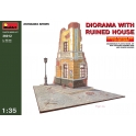 Diorama with runied house