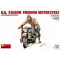 U.S. Soldier Pushing Motorcycle